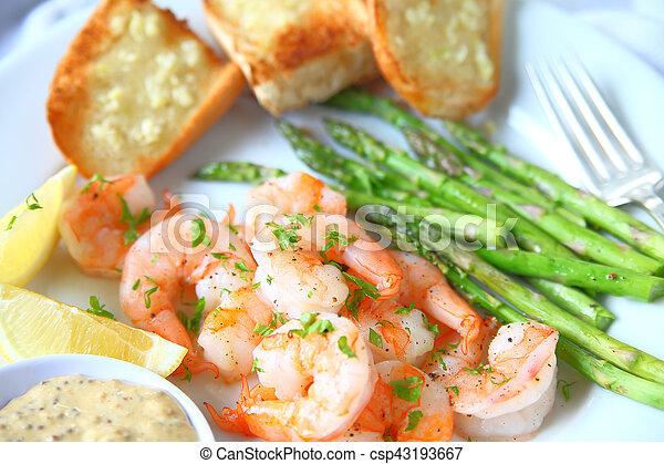Dinner of shrimp and garlic bread - csp43193667