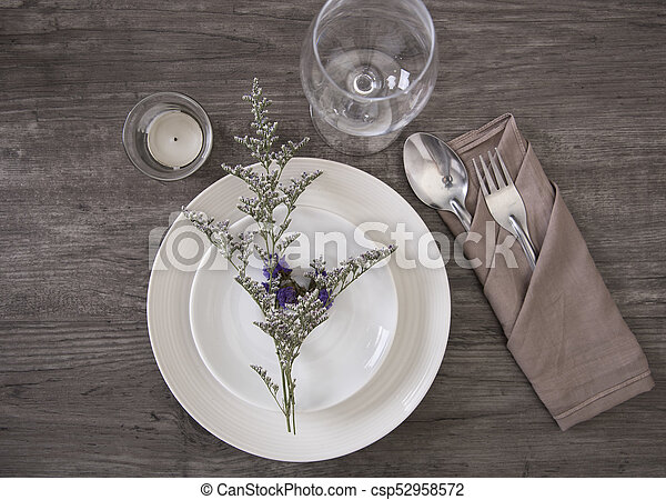 & Dinner plate setting on wood table top view.