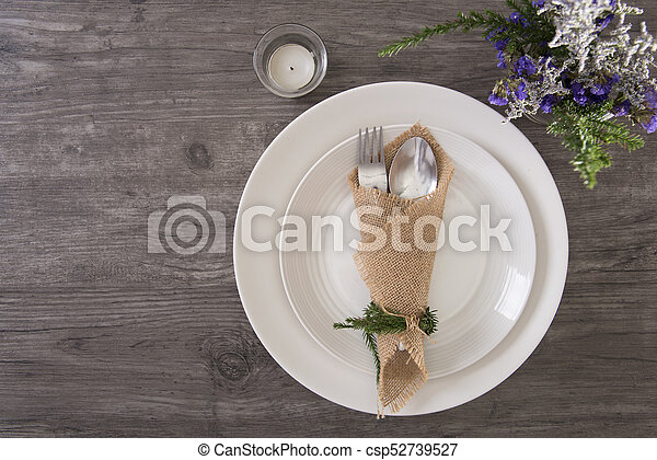 Dinner plate setting on wood table top view. - csp52739527 & Dinner plate setting on wood table top view. stock photo - Search ...