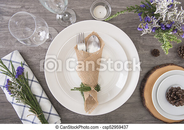 Dinner plate setting on wood table top view. - csp52959437 & Dinner plate setting on wood table top view. stock photos - Search ...