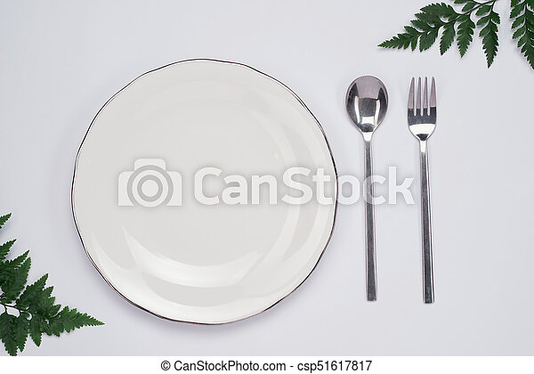 Dinner plate setting top view. Empty plate and silverware set on wooden table - csp51617817 & Dinner plate setting top view. empty plate and silverware... stock ...