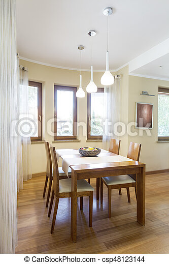 Dinning area with classic wooden table - csp48123144