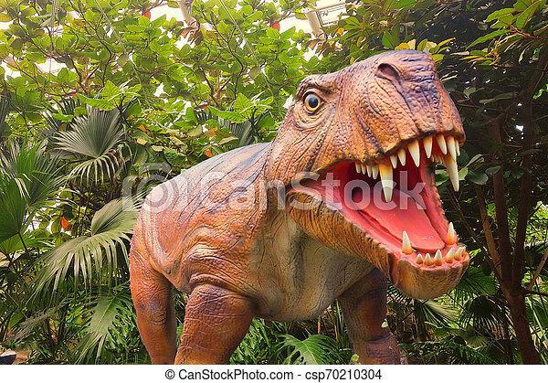 Dinosaur in a jungle - csp70210304