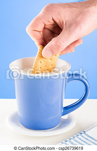 Dipping a Biscuit in Milk - csp26739619