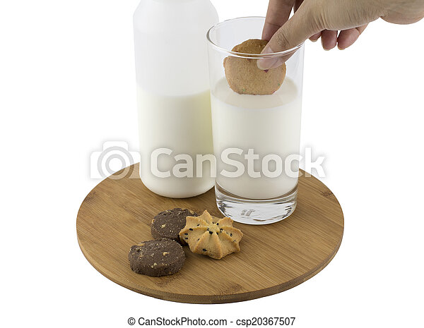 Dipping cookie in glass of milk - csp20367507