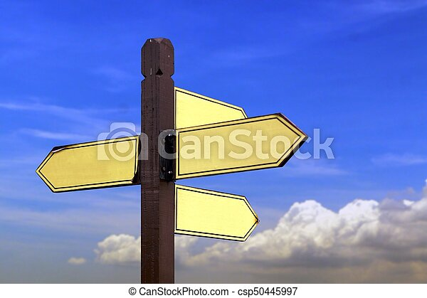 Direction sign board under cloudy blue sky - csp50445997