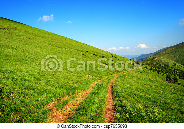 dirt long road among green hills - csp7655093