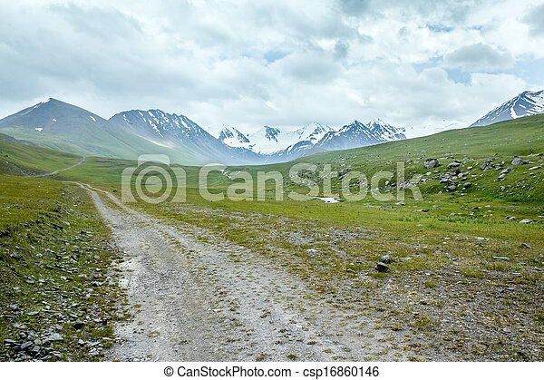 Dirt road in mountains - csp16860146