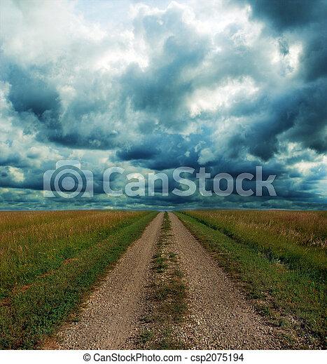 Dirt Road Through the Prairie in Storm - csp2075194