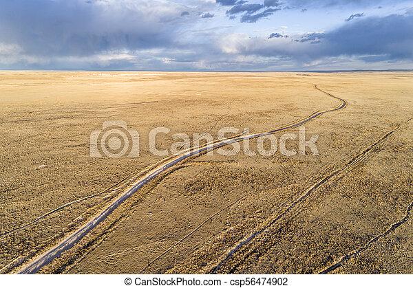 Dirt road winding through prairie in northern Colorado - csp56474902