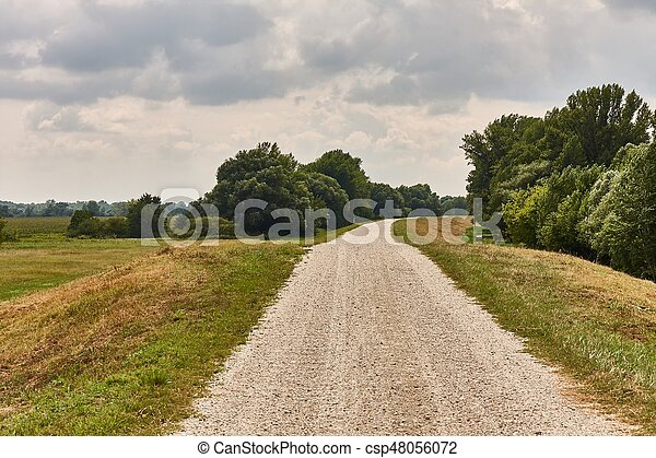 Dirtroad through on a dike - csp48056072