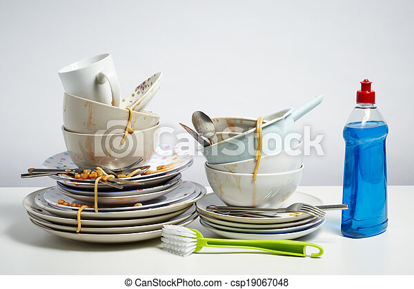 Dirty dishes pile needing washing up on white background - csp19067048