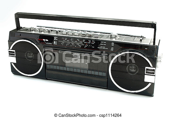 Dirty old 1980s style cassette player radio against a white background - csp1114264