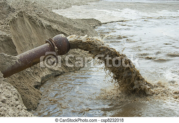 Dirty water flows from a pipe. toxic production wastes ...