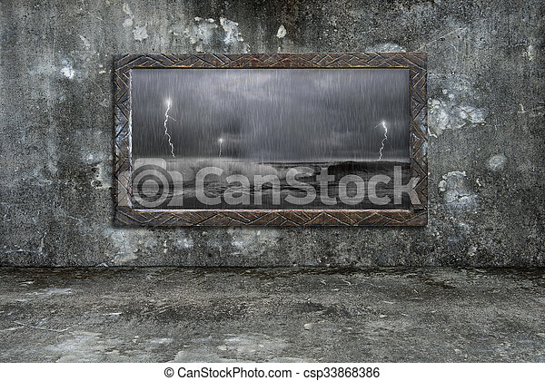 Dirty wooden frame window on mossy wall with storm outside - csp33868386