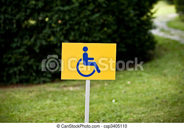 Disability sign on grass background - csp3405110