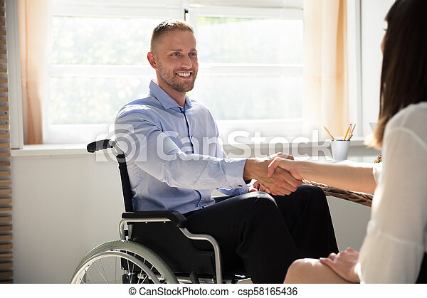 Disabled Businessman Shaking Hand With His Partner - csp58165436