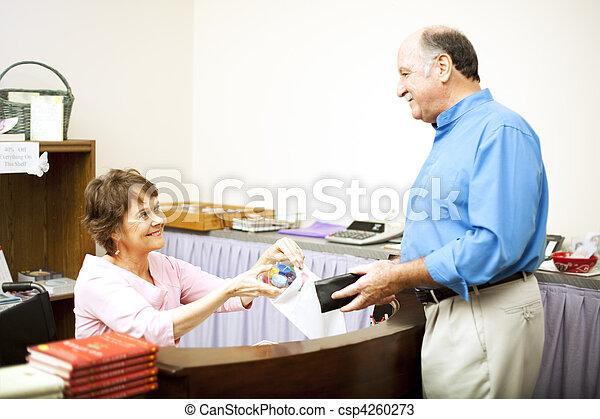 Disabled Clerk Serves Customer - csp4260273
