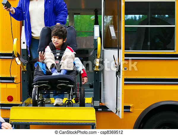 Disabled five year old boy using a bus lift for his wheelchair - csp8369512