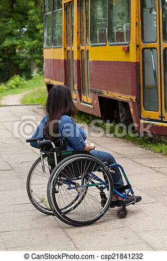 Disabled girl waiting for a tram - csp21841232