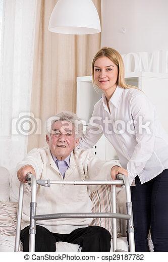 Disabled man using walking frame - csp29187782