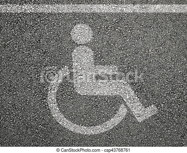 Disabled parking sign on asphalt - csp43768761
