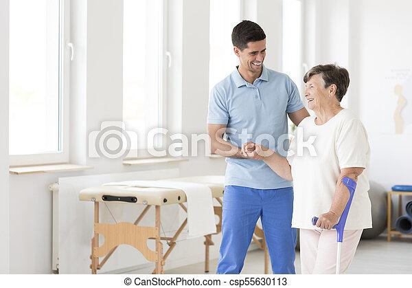 Disabled senior woman during rehabilitation - csp55630113