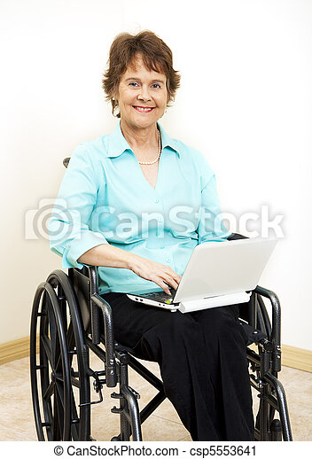 Disabled Woman with Netbook - csp5553641