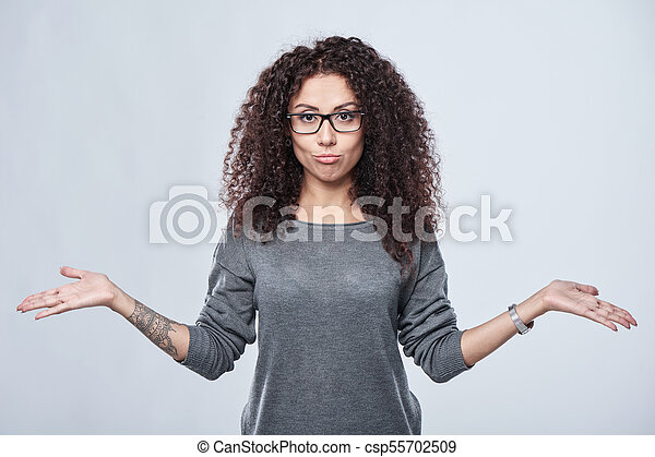 disappointed woman with two opened hand palms - csp55702509
