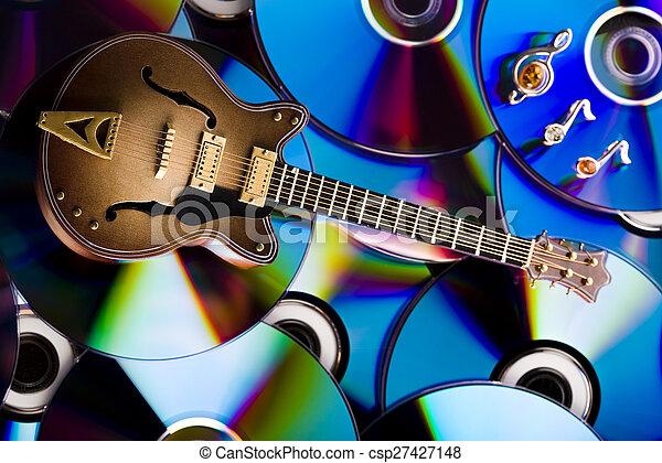 Discs and guitar, bright colorful vivid theme - csp27427148