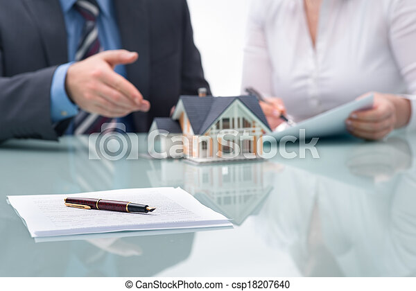 Discussion with a real estate agent - csp18207640