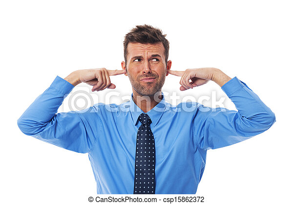Disgust business man with fingers in ears - csp15862372
