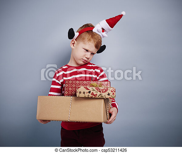 Displeased boy with christmas present - csp53211426