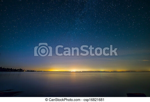 Distant City Lights With Stars and Water - csp16821681