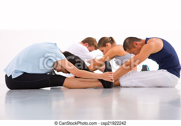 Diverse group of people doing yoga - csp21922242