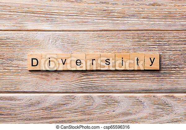 Diversity word written on wood block. Diversity text on wooden table for your desing, concept - csp65596316