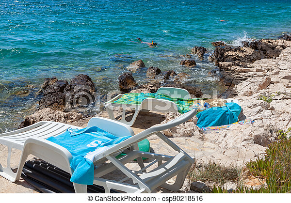 Diving in the Adriatic by the rocks - csp90218516