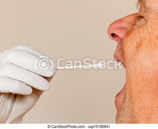 DNA swab of saliva taken from senior man - csp10195641