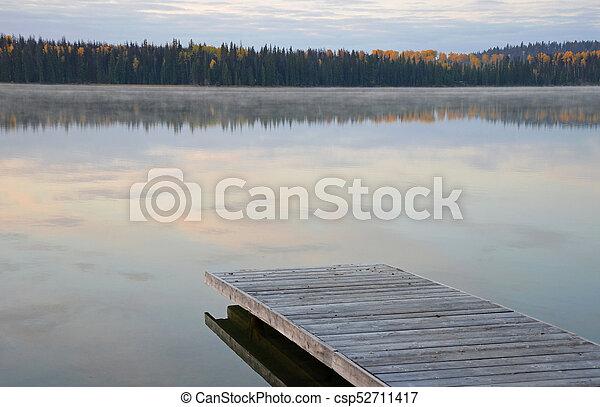 Dock on peaceful lake - csp52711417