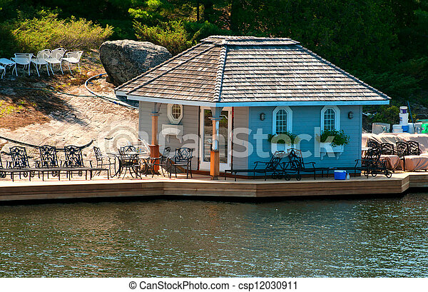 Dock with a small cottage - csp12030911