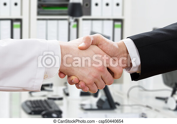Doctor And Businessman Shaking Hand - csp50440654