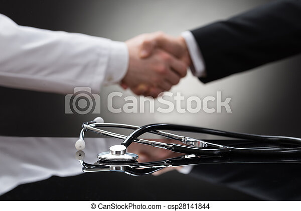 Doctor And Businessman Shaking Hand - csp28141844