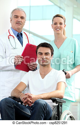 Doctor and nurse with patient in wheelchair - csp8251291