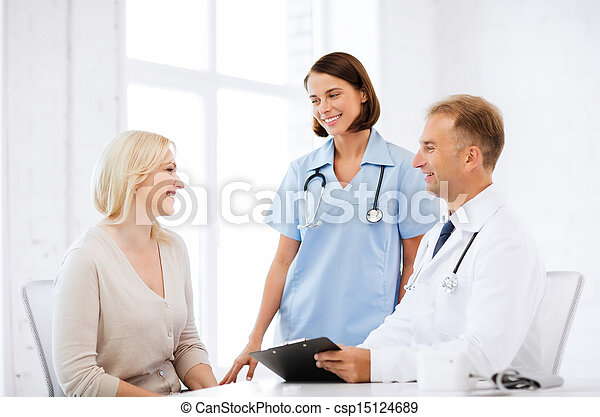 doctor and nurse with patient in hospital - csp15124689
