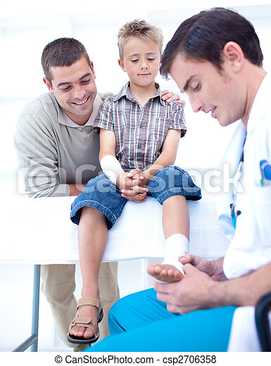 Doctor bandaging a child's foot - csp2706358