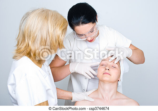Doctor checking patient woman skin - csp3744674