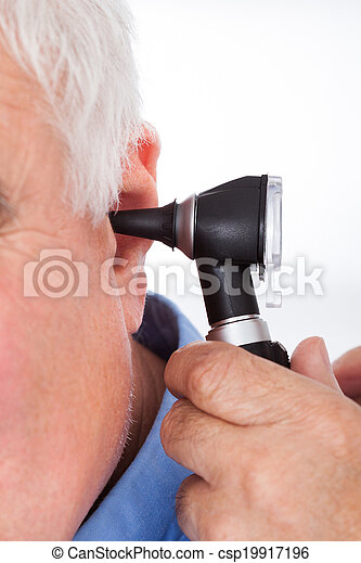 Doctor Checking Senior Man's Ear With Otoscope - csp19917196
