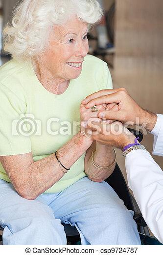 Doctor Comforting Senior Woman - csp9724787