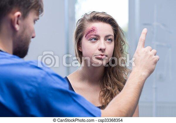 Doctor diagnosing injured woman - csp33368354