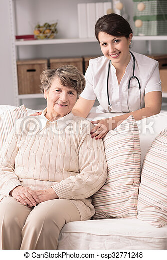 Doctor during home visit - csp32771248